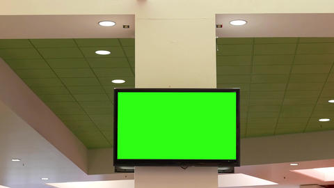 Motion of green screen tv for your ad on wall at food court area inside Coquitla Live Action