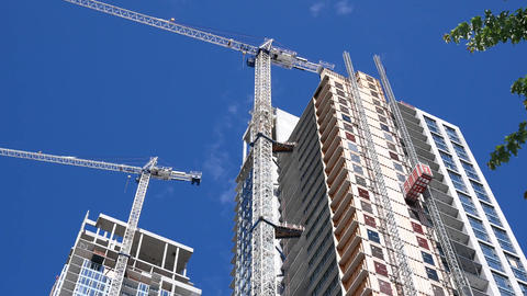Motion of modern high rise building with construction crane 4k resolution Footage