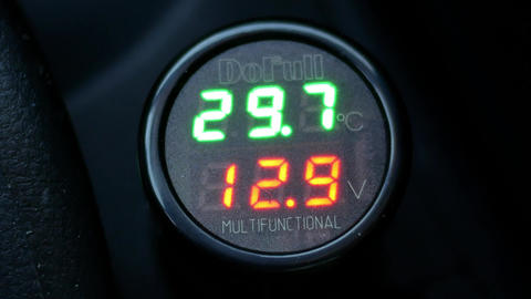 Motion of voltmeter voltage meter testing data while starting car engine Footage