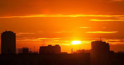 Sunrise over a big city. Time Lapse Footage
