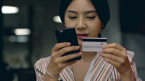 Teenage Girl Using a Mobile Phone to Buy Online Products Footage