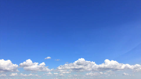 Blue sky with white fluffy clouds Footage