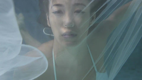 Beautiful woman underwater Footage