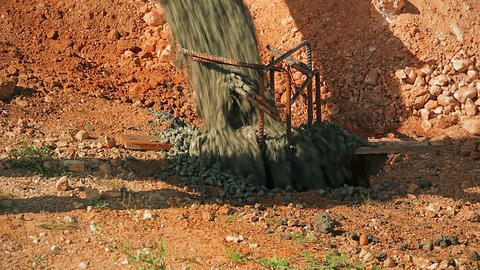 Cinemagraph of Concrete poured into a pit in the ground from concrete mixer Image
