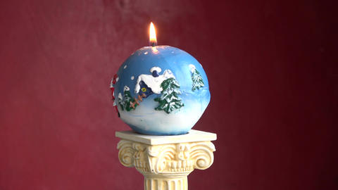 Rotating decorative New Year Christmas candle on column model Footage