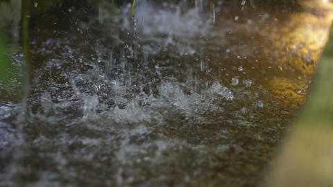 Heavy rain drop on water surface slow motion Image
