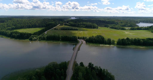 Clouds above a bridge, Cinema 4k aerial view of clouds sailing above a small Live Action