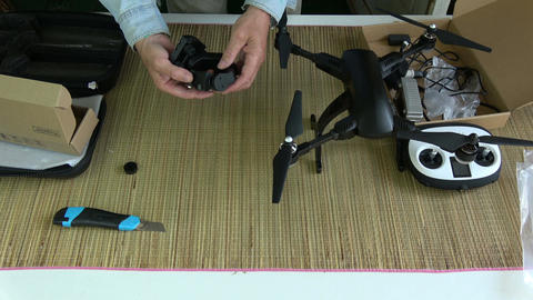 photographer testing new foldable drone camera on gimbal Live Action