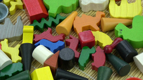Rotating various wooden and plastic toys colorful background Footage