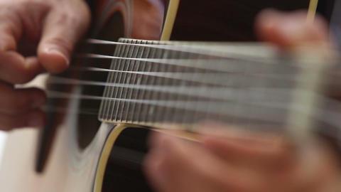 european man plays guitar on fingerboard Footage