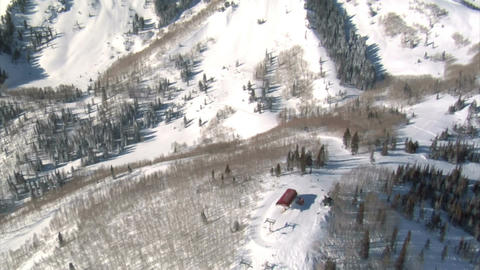 Aerial shot of ski resort lift and peaks Footage
