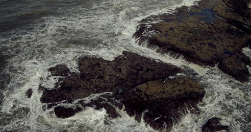 Aerial shot of the waves flowing toward the coast Footage