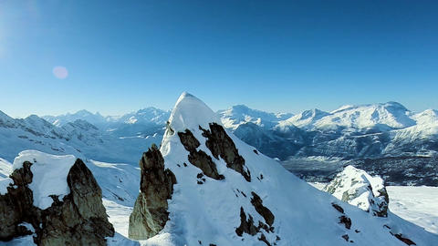 Majestic mountains panorama aerial view fly over winter snow landscape Footage