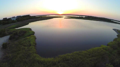 Sunset over sound and sand aerial Footage