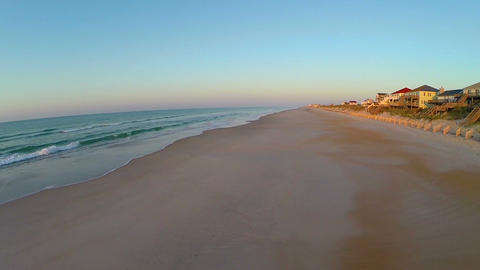 Vibrant morning colors over empty beach Footage