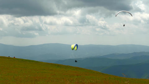 4k, Paraglider flying high in the mountains Live Action