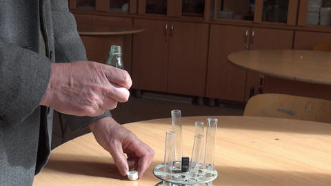 Chemistry class experiment. Professor mix two substances, after which you get a  Footage