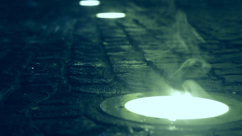 Drops Of Water Falling Over A Fixed Reflector In Street Pavement 6 stock footage
