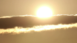 Great sun rises and is hidden behind a cloud and then again shines in the sky 46 Footage