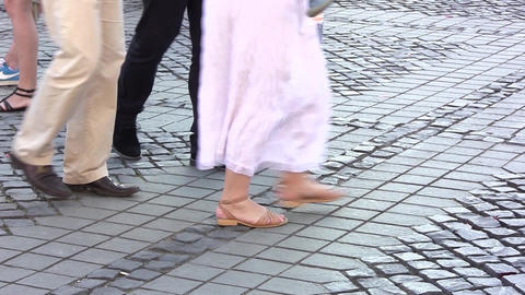 Legs of people, pedestrians, tourists through the center of the old city. Consis Footage