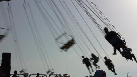 On a sunny summer day, many people are in an amusement park, are given with a ca Footage