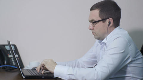 Side View Office Worker Types on Laptop Keyboard Live Action