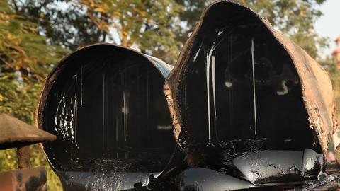black hot tar bubbling Live Action