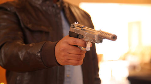 Revolver in a hand Stock Video Footage