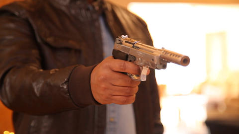 Revolver in a hand Live Action