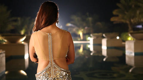 Rear view of Female sexy Model Live Action