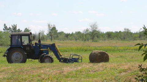 Tractor loading hay 2 Footage