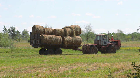 Tractor loading hay 3 Footage