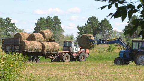 Tractor loading hay 6 Footage