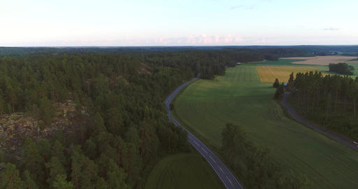 Road on the countryside, Cinema 4k aerial view following a asphalt road, on the Footage