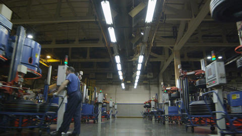 Camera Removes Fast along Large Production Plant Workshop Live Action