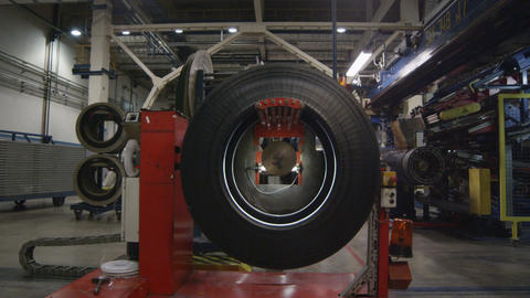 Camera Moves into and back Tyre Shows Metal Rotating Machine Footage