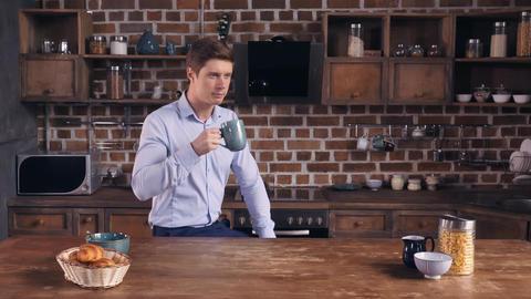 Male has unhealthy breakfast in flat Footage