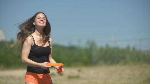 4K Attractive Caucasian Woman Playing Frisbee Outdoors Footage