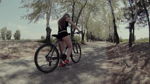 4K A Woman Riding A Bike Footage