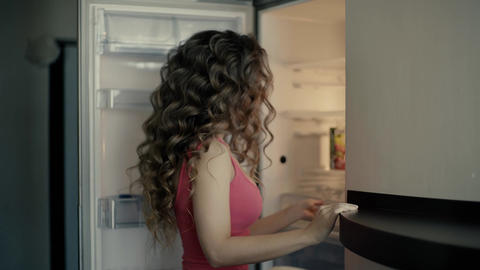 4K The Girl Looks Around And Goes To The Fridge Footage
