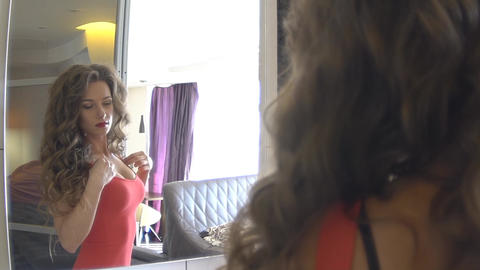 Beautiful Girl In Red Dress Looking In The Mirror Slow Motion Footage