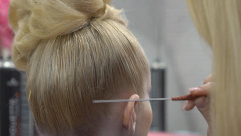 Hair Stylist Drying Blonde Hair, Slow Motion Footage