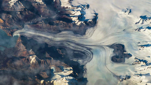 Flying over the earth on the ISS. Flying over the snow-capped mountains, aerial Footage