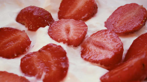 Eating strawberries with cream or yogurt by spoon, 4k Footage