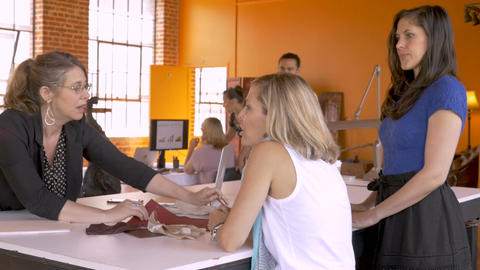 Hispanic man arrives to an all young attractive women business meeting as they Footage