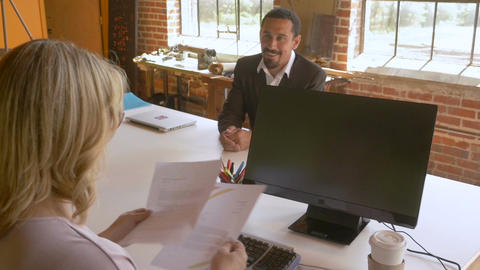 Confident attractive powerful woman boss reviewing job resume hires latino man Footage