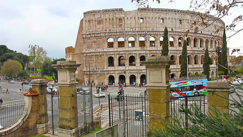 ROME, ITALY - March 25, 2017: Tourist bus in Rome in the background of Colosseum 画像