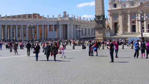 VATICAN CITY, VATICAN - March 26, 2017: Tourists visiting the Square and the Footage