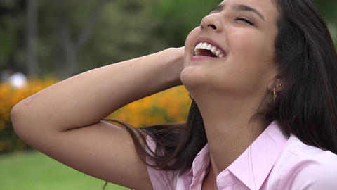 Pretty Hispanic Female Teen Laughing Live Action