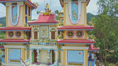 Camera Shows Decorated Temple Facade against Green Nature Live Action